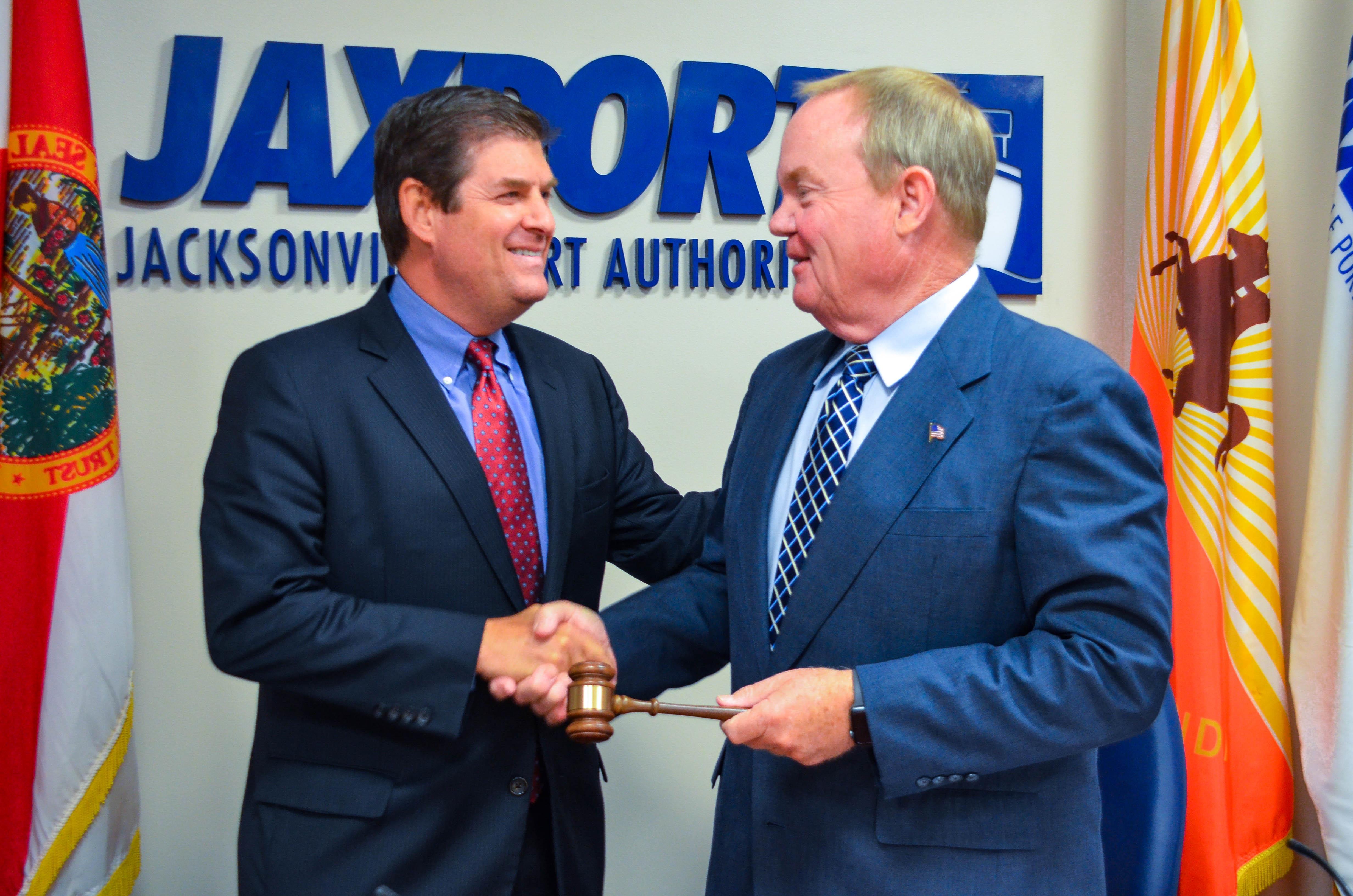 JAXPORT Immediate Past Board Chairman Ed Fleming (right) passes the gavel to incoming Chairman John Falconetti