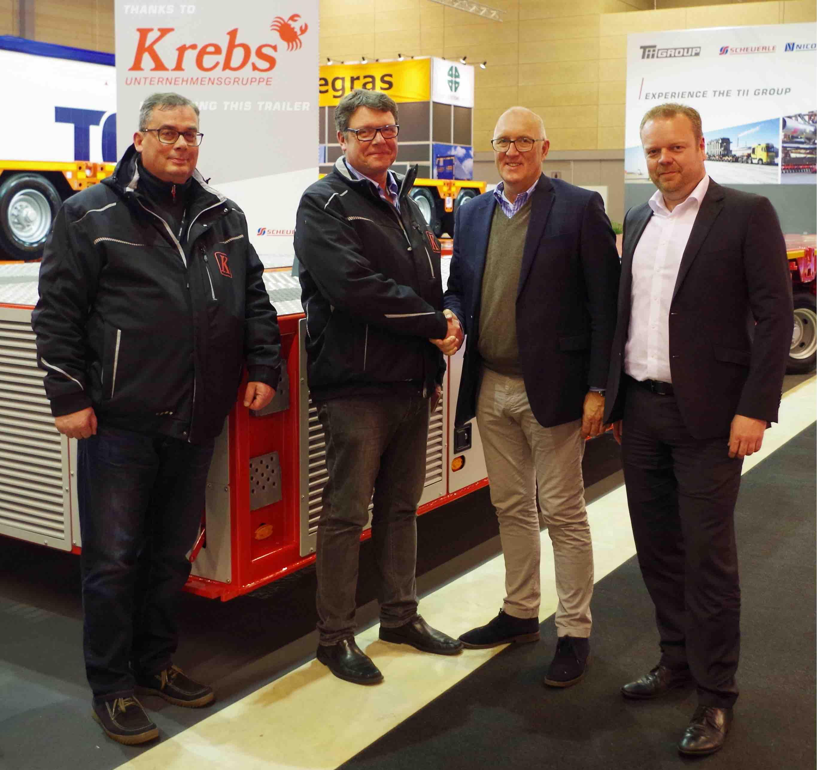 Caption: The handover of the axle lines took place at Transport Fair 2019 in Denmark. From left to right: Jörg Neuhäusel, technical director, Krebs Group; owner Detlef Krebs; Bernd Schwengsbier, president TII Sales; and Markus Pflederer, key account manager, TII Sales.