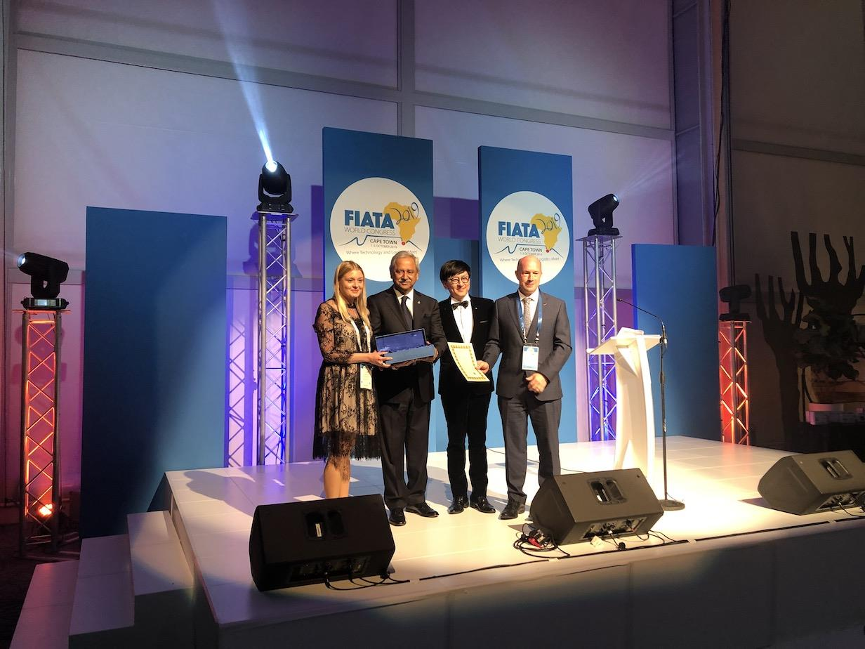 From left to right: YIFFY award winner Evgeniya Khokhlova; FIATA president Babar Badat; Thomas Sim, chairman of FIATA's advisory body vocational training; and TT Club's Michael Yarwood, chairman of the award steering committee.