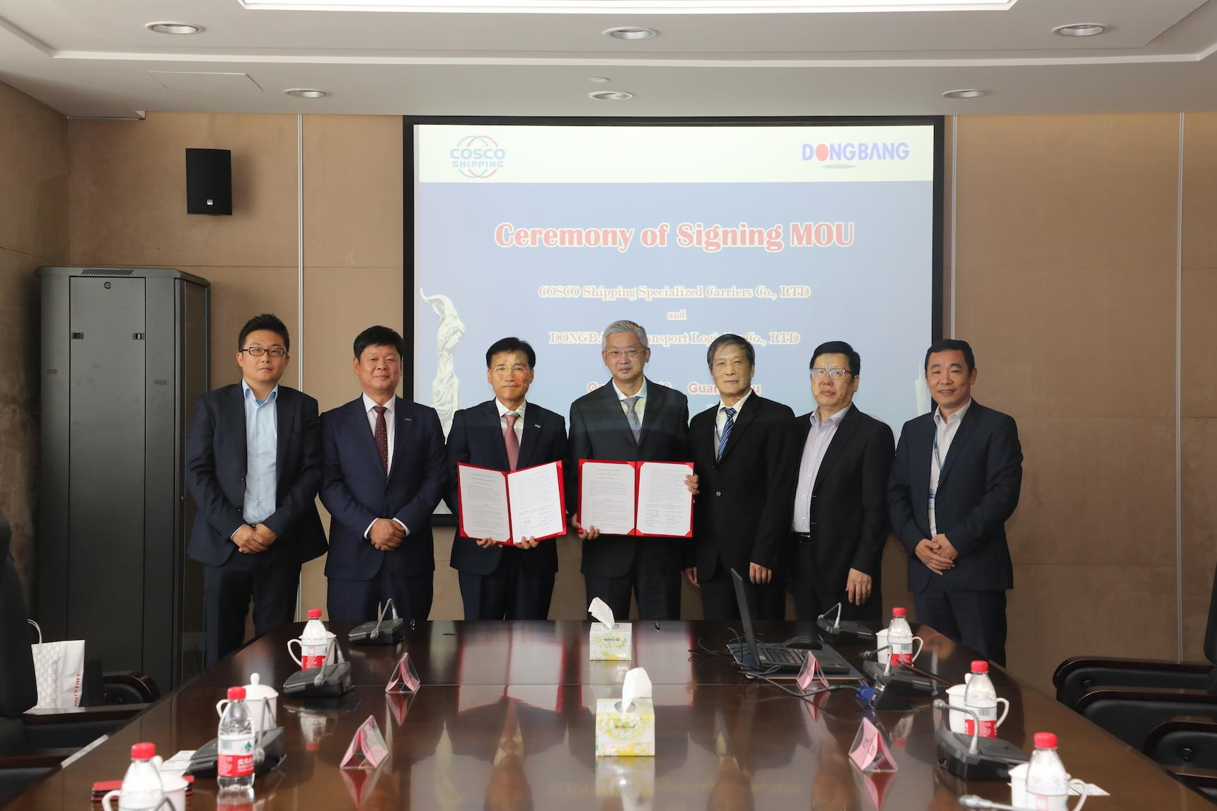 From left to right: Kris Bae, UK branch representative for Dongbang;  Woon Gun Jung, Dongbang's vice president; Kyung Min Seong, Dongbang president; Wei Chen, COSCO's president; Ya Chun Wu, vice president; Xiao Hong Qiu, general manager at COSCO; and COSCO's deputy general manager Wei Liu.